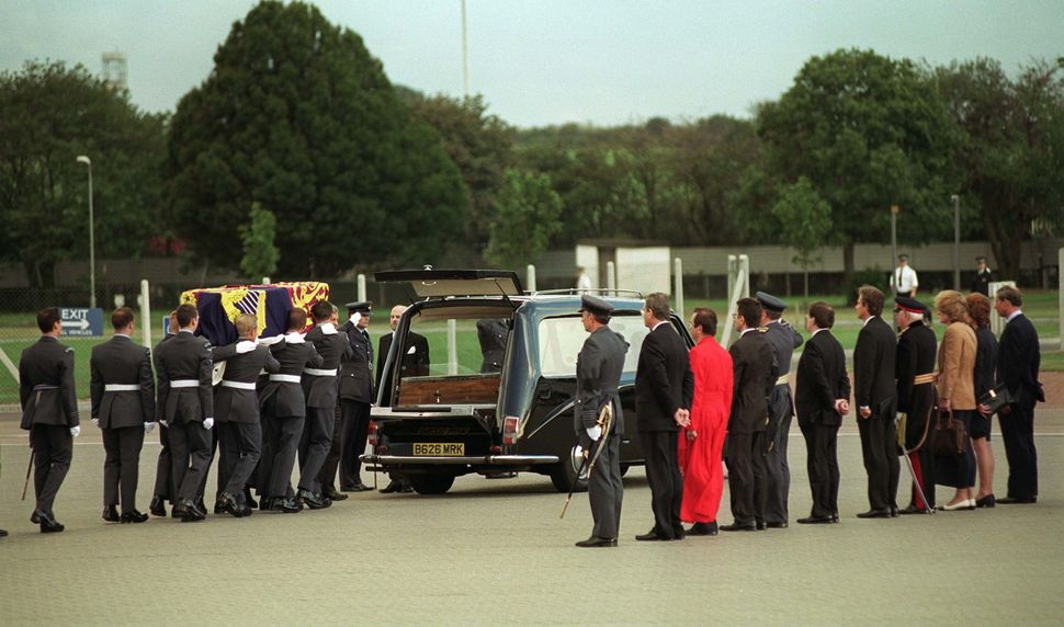 Prince Charles with Lady Sarah Mccorquodale, Lady Jane Fellowes and Prime Minister Tony Blair watching as the coffin of Diana