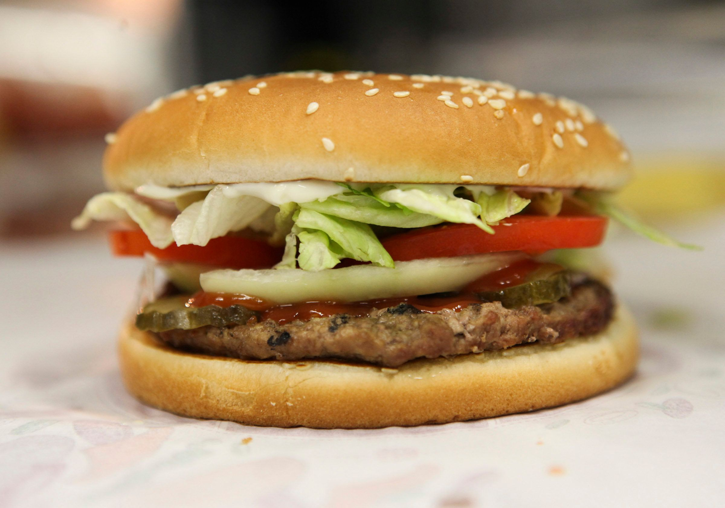 A whopper burger sits in the kitchen at a Burger King restaurant in Basildon, U.K., on Wednesday, Sept. 8, 2010. Burger King Holdings Inc. agreed to be acquired by 3G Capital, a New York investment firm backed by Brazilian investors, for $3.3 billion in the biggest restaurant acquisition in at least a decade. Photographer: Chris Ratcliffe/Bloomberg via Getty Images