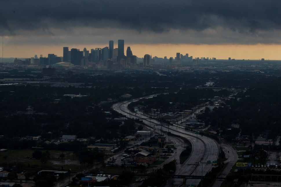 An aerial view of downtown Houston under dark clouds.