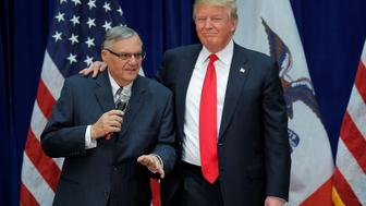 FILE PHOTO: U.S. Republican presidential candidate Donald Trump is joined onstage by Maricopa County Sheriff Joe Arpaio (L) at a campaign rally in Marshalltown, Iowa January 26, 2016, after Arpaio endorsed Trump's cacndidacy.  REUTERS/Brian Snyder/File Photo