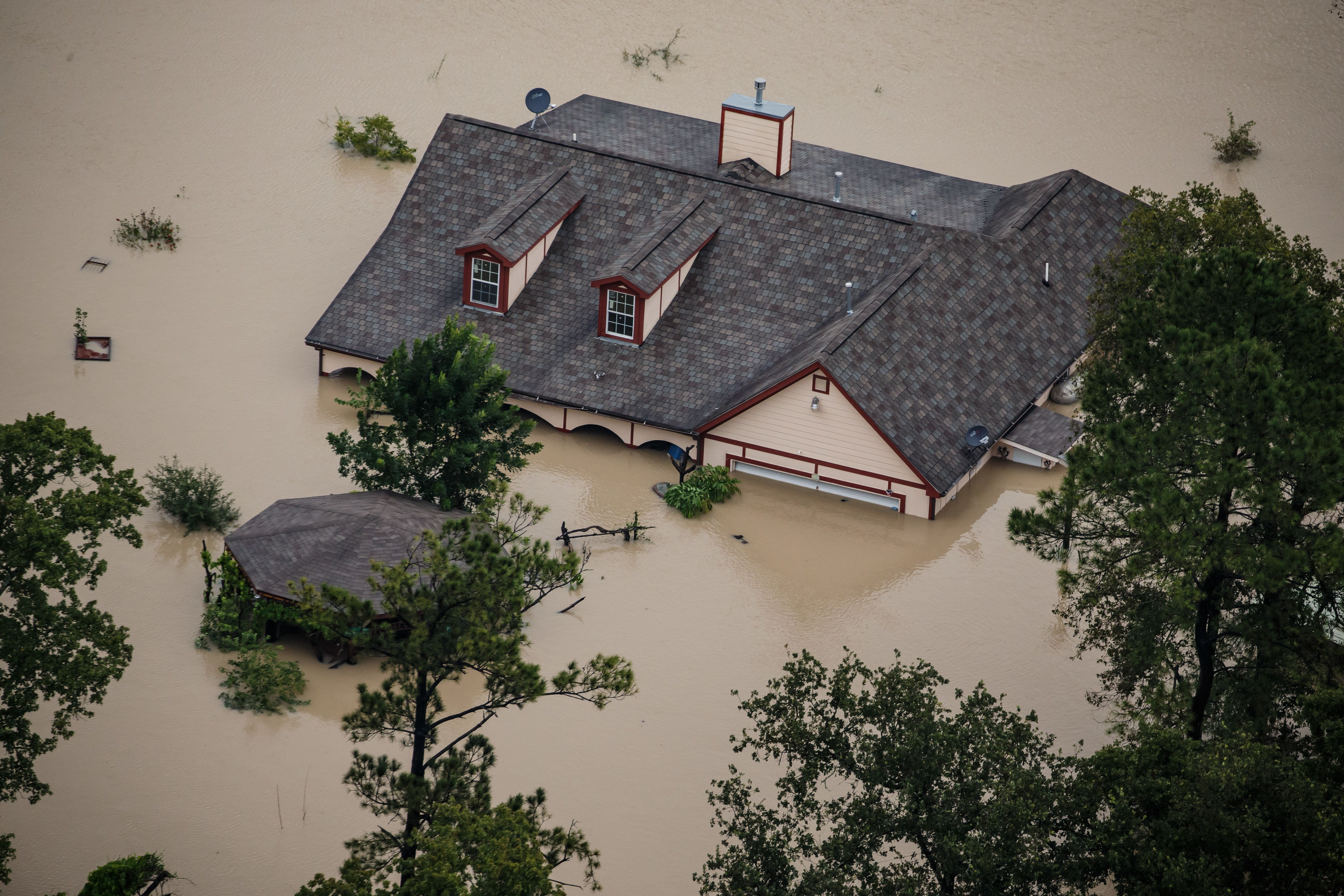 HOUSTON, TEXAS -- TUESDAY, AUGUST 29, 2017: A house sits completely submerged in flood water in the wake of Hurricane Harvey in Houston, Texas, on Aug. 29, 2017. (Marcus Yam / Los Angeles Times)