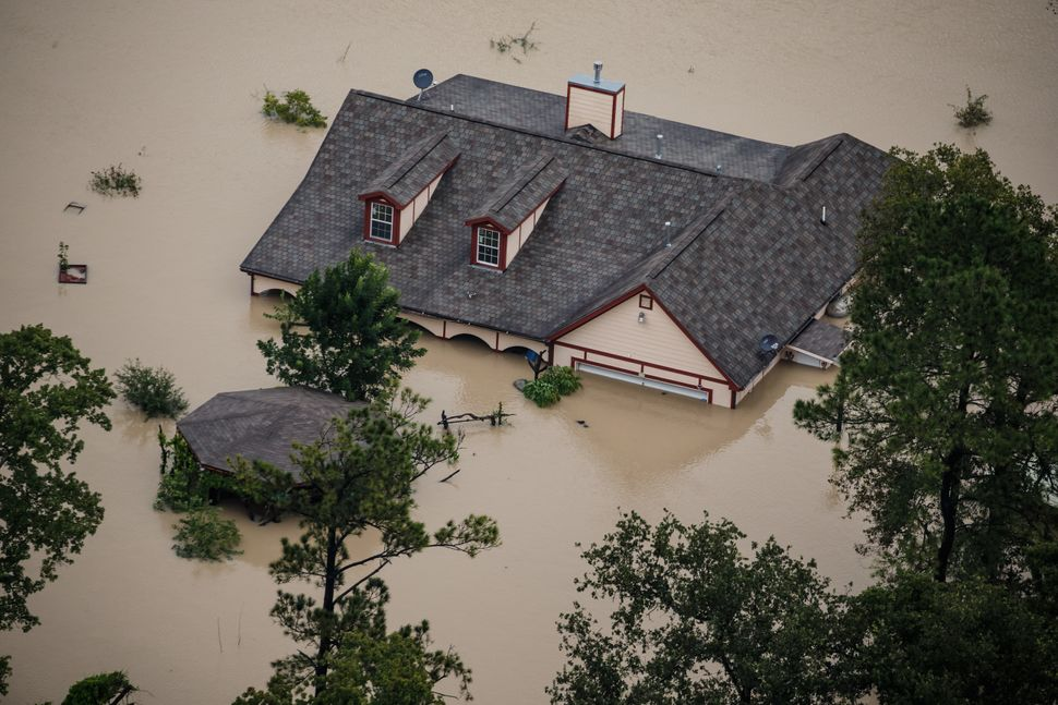 A Houston house sits submerged in floodwater after Hurricane Harvey.