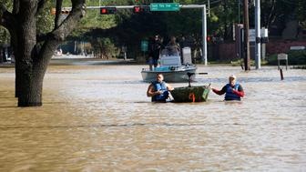 Volunteers with boats return after looking for victims stuck in Tropical Storm Harvey floodwaters in western Houston, Texas August 30, 2017. REUTERS/Rick Wilking
