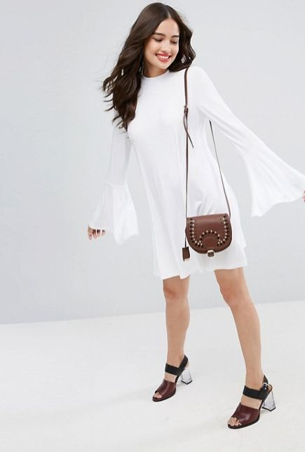 """<a href=""""http://us.asos.com/asos/asos-high-neck-swing-dress-in-rib-with-fluted-sleeve/prd/8549086?clr=white&SearchQuery=&"""