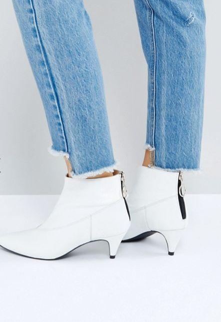 "<a href=""http://us.asos.com/gestuz/gestuz-white-patent-boots/prd/8477820?clr=white&SearchQuery=&cid=13504&pgesize"