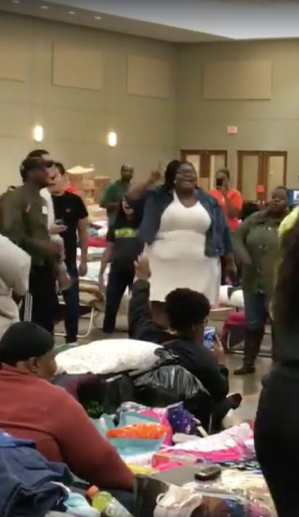 A woman breaks into gospel at a shelter for Hurricane Harvey victims in Conroe,