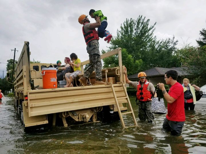 A photo made available by the Texas Military Department shows Texas National Guard soldiers arriving to aid citizens in heavi