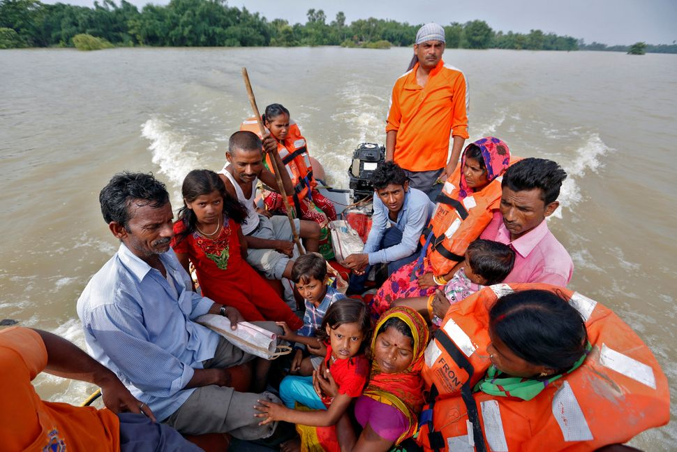 People are rescued from a flooded village in Bihar State on Aug. 22.