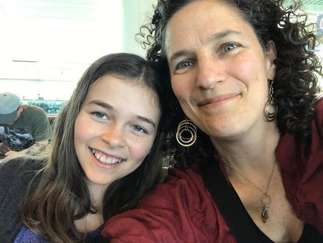 Lisa Frack, president of the board of Oregon NOW, with her 11-year-old daughter Georgia.