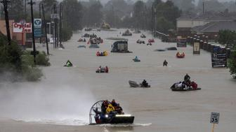 Residents use boats to evacuate flood waters from Tropical Storm Harvey along Tidwell Road east Houston, Texas, U.S. August 28, 2017. REUTERS/Adrees Latif     TPX IMAGES OF THE DAY