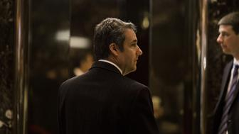 Attorney Michael Cohen arrives at Trump Tower in New York, U.S., on Thursday, Jan. 12, 2017. Donald Trump is slated to meet with AT&T Inc.'s top executives on Thursday to discuss the company's proposed $85.4 billion bid for Time Warner Inc., according to people familiar with the matter. The president-elect has said he opposes the deal. Photographer: John Taggart/Bloomberg via Getty Images