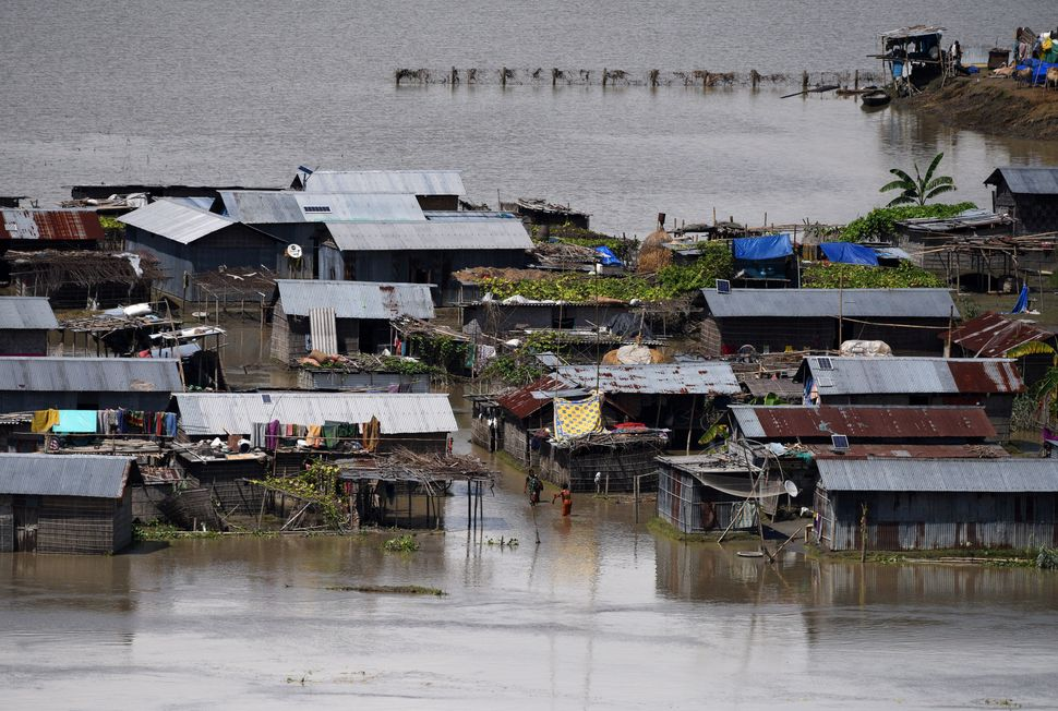 Partially submerged houses are seen in a village in Morigaon district in the northeastern state of Assam on Aug. 20