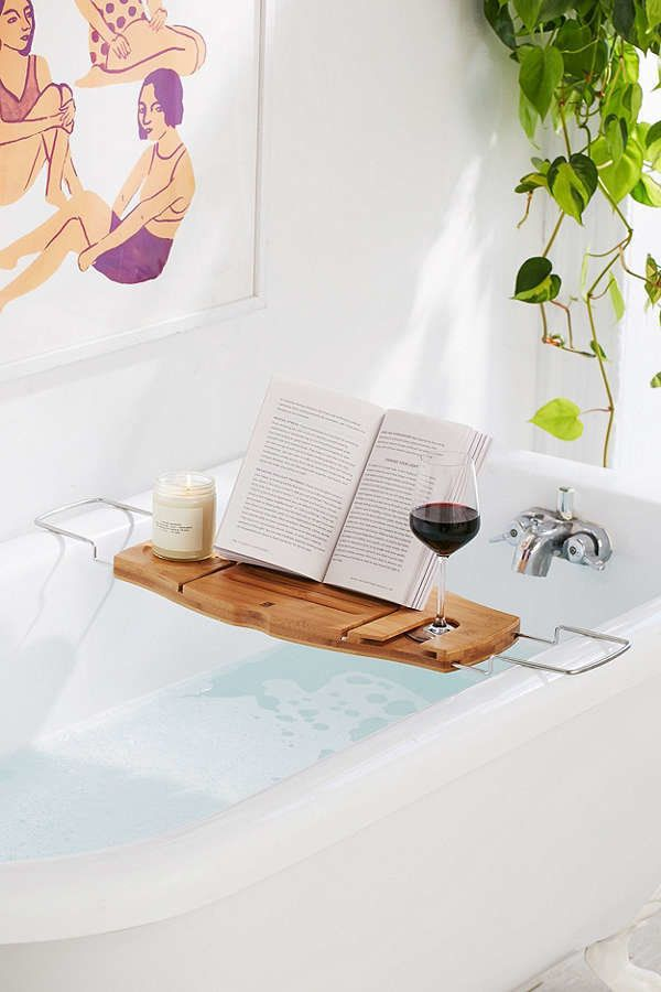 """<a href=""""https://www.urbanoutfitters.com/shop/me-time-bamboo-bath-tray-caddy"""" target=""""_blank"""">Shop it here</a>."""