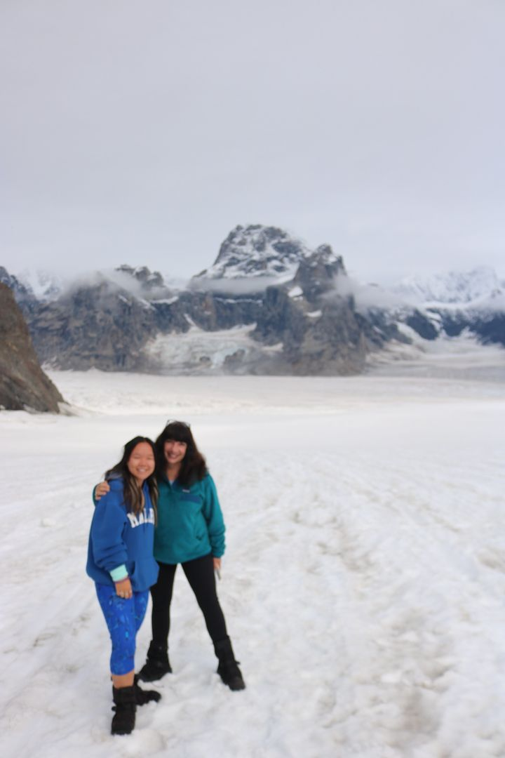 The author and her daughter after landing on a glacier accessible only by ski plane.