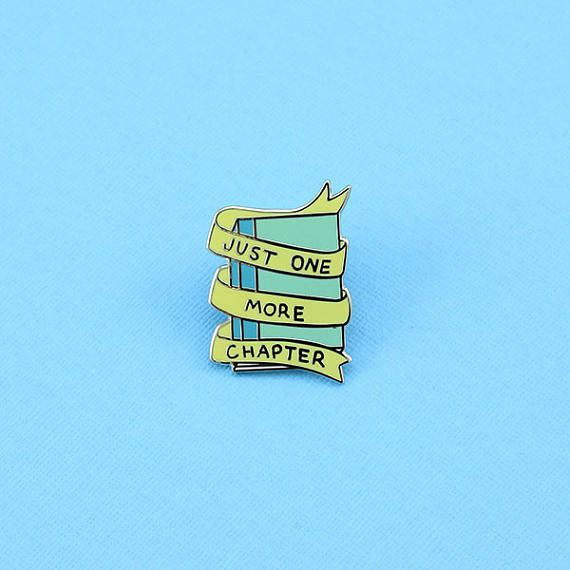 """<a href=""""https://www.etsy.com/listing/524730342/just-one-more-chapter-enamel-pin?ga_order=most_relevant&ga_search_type=al"""