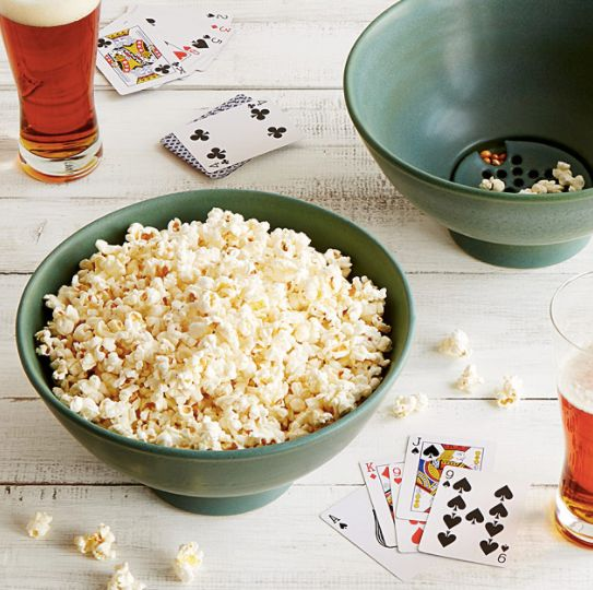 """IT'S GENIUS. <a href=""""https://www.uncommongoods.com/product/the-popcorn-bowl-with-kernel-sifter"""" target=""""_blank"""">Shop it here"""