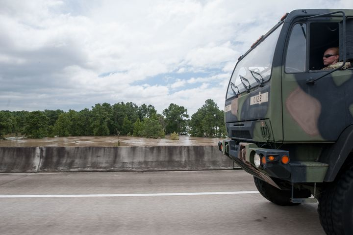 A military vehicle heads toward Port Arthur, on the Gulf Coast near the Louisiana border.