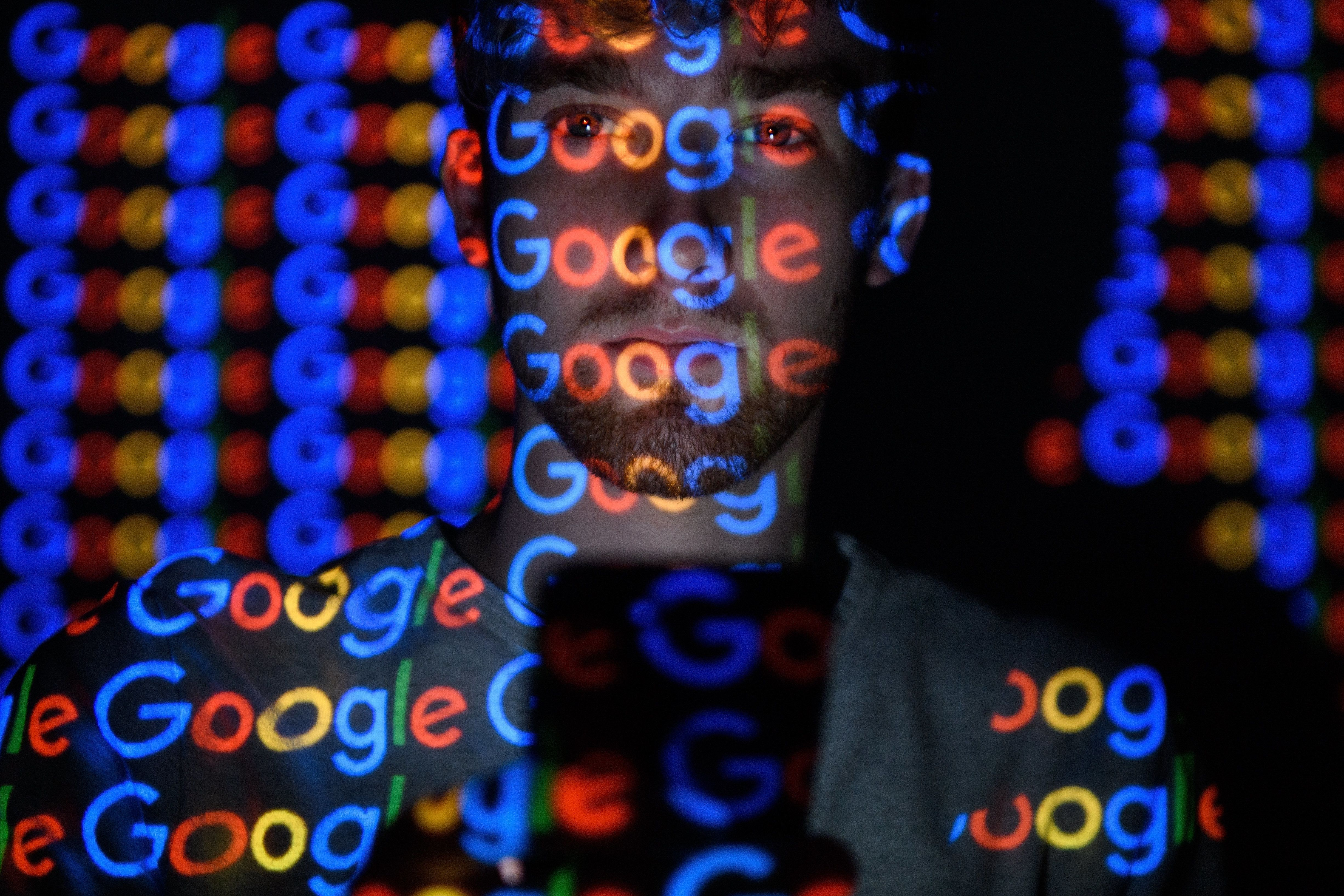 LONDON, ENGLAND - AUGUST 09:  In this photo illustration,  The Google logo is projected onto a man on August 09, 2017 in London, England. Founded in 1995 by Sergey Brin and Larry Page, Google now makes hundreds of products used by billions of people across the globe, from YouTube and Android to Smartbox and Google Search.  (Photo by Leon Neal/Getty Images)