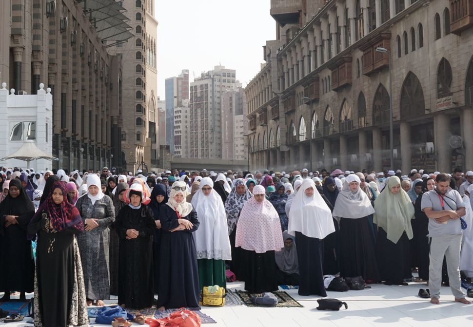 Muslim worshippers pray outside the Grand Mosque in the holy city of Mecca in Saudi Arabia.