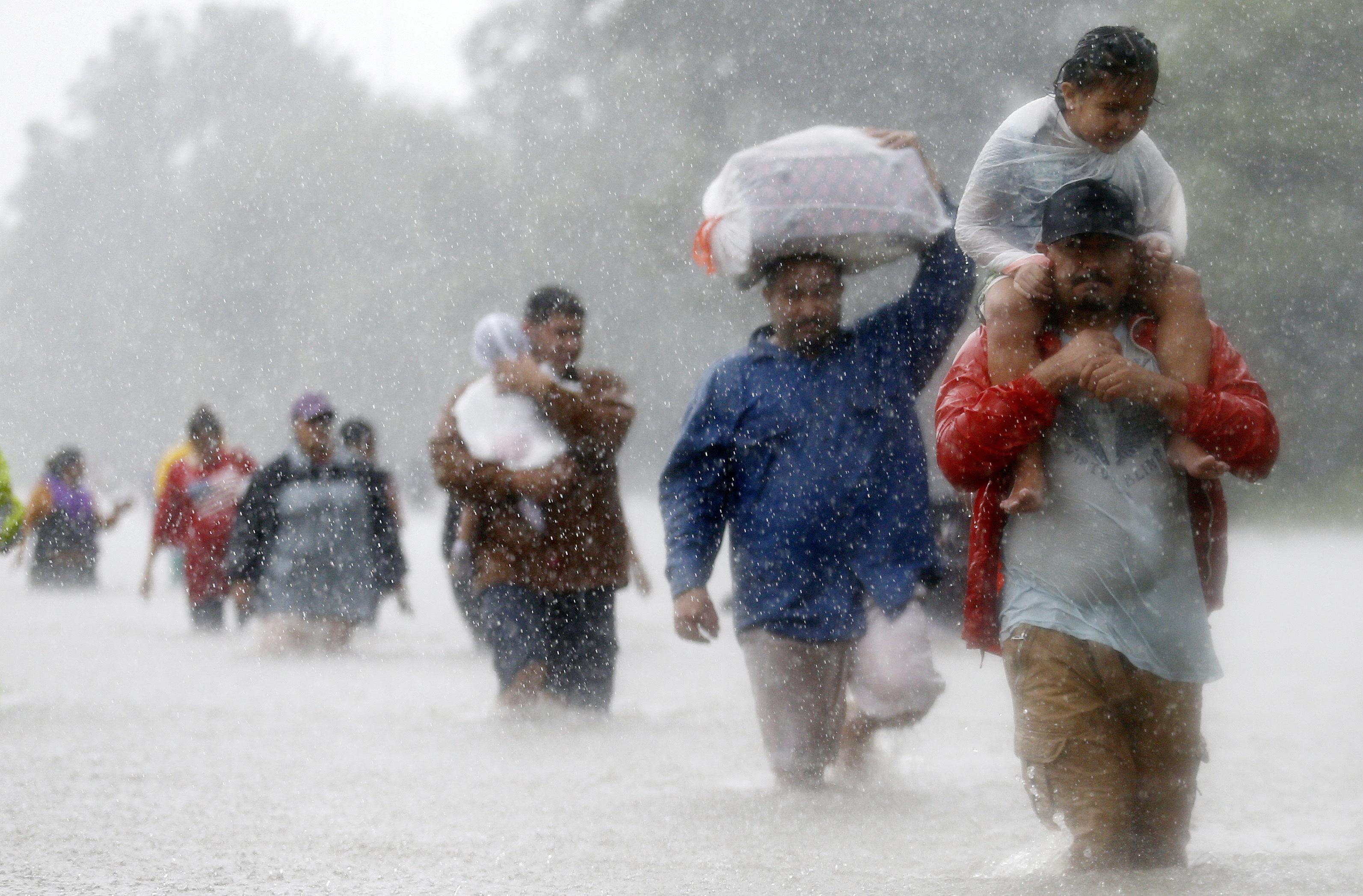 Houston residentswade through floodwaters on Aug. 28.