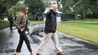 US President Donald Trump and First Lady Melania Trump depart the White House in Washington, DC, on August 29, 2017 for Texas to view the damage caused by Hurricane Harvey. / AFP PHOTO / NICHOLAS KAMM        (Photo credit should read NICHOLAS KAMM/AFP/Getty Images)