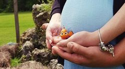 The Poignant Reason This Couple Posed With Nemo During Maternity