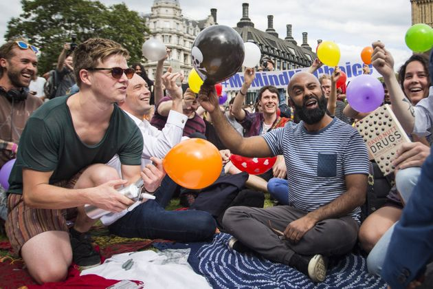 Dozens of protesters stage a mass inhalation of nitrous oxide outside the House of Parliament in August...