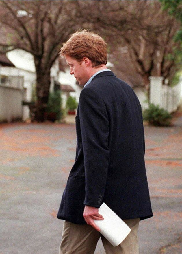 Princess Dianas brother Earl Spencer turns away from the press after reading a brief statement about...