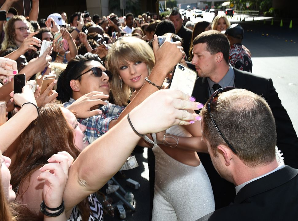 Taylor Swift takes selfies with fans during the 2015 Billboard Music Awards at MGM Grand Garden Arena on May 17, 2015, in Las