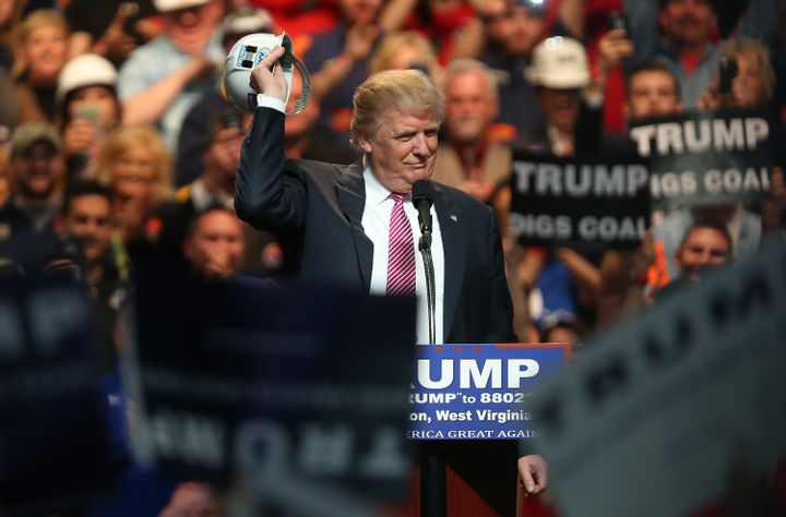 Then-candidate Donald Trump signals support for coal miners during a May 2016 rally in West Virginia. He campaigned as a