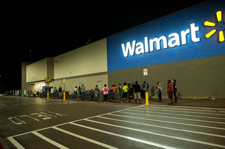 People wait in line early Thursday morning for a Beaumont, Texas, Walmart to open.