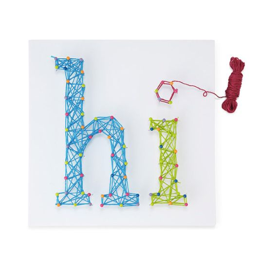 """<a href=""""https://www.uncommongoods.com/product/diy-string-art-kit"""" target=""""_blank"""">Shop it here</a>."""
