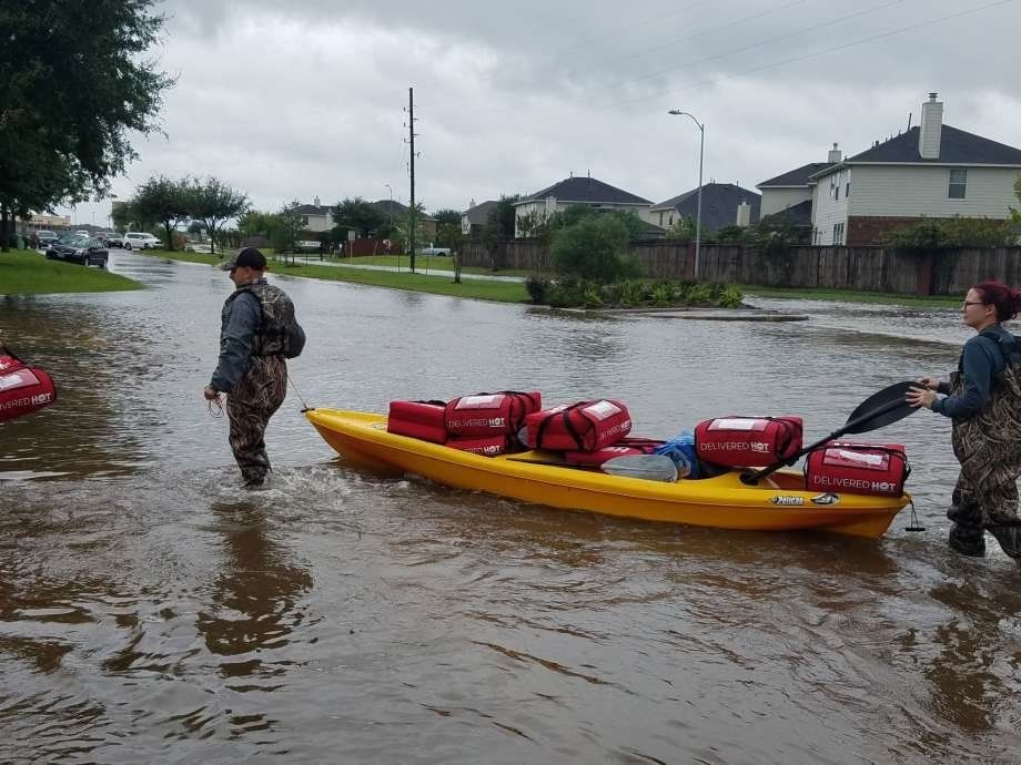 Pizza Hut employees deliver pizzas to flooded homes in southeast Texas this week.