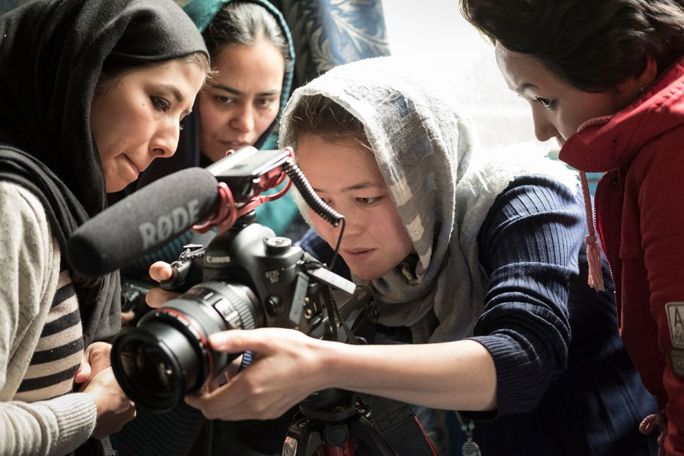 Female Afghan journalist in training.