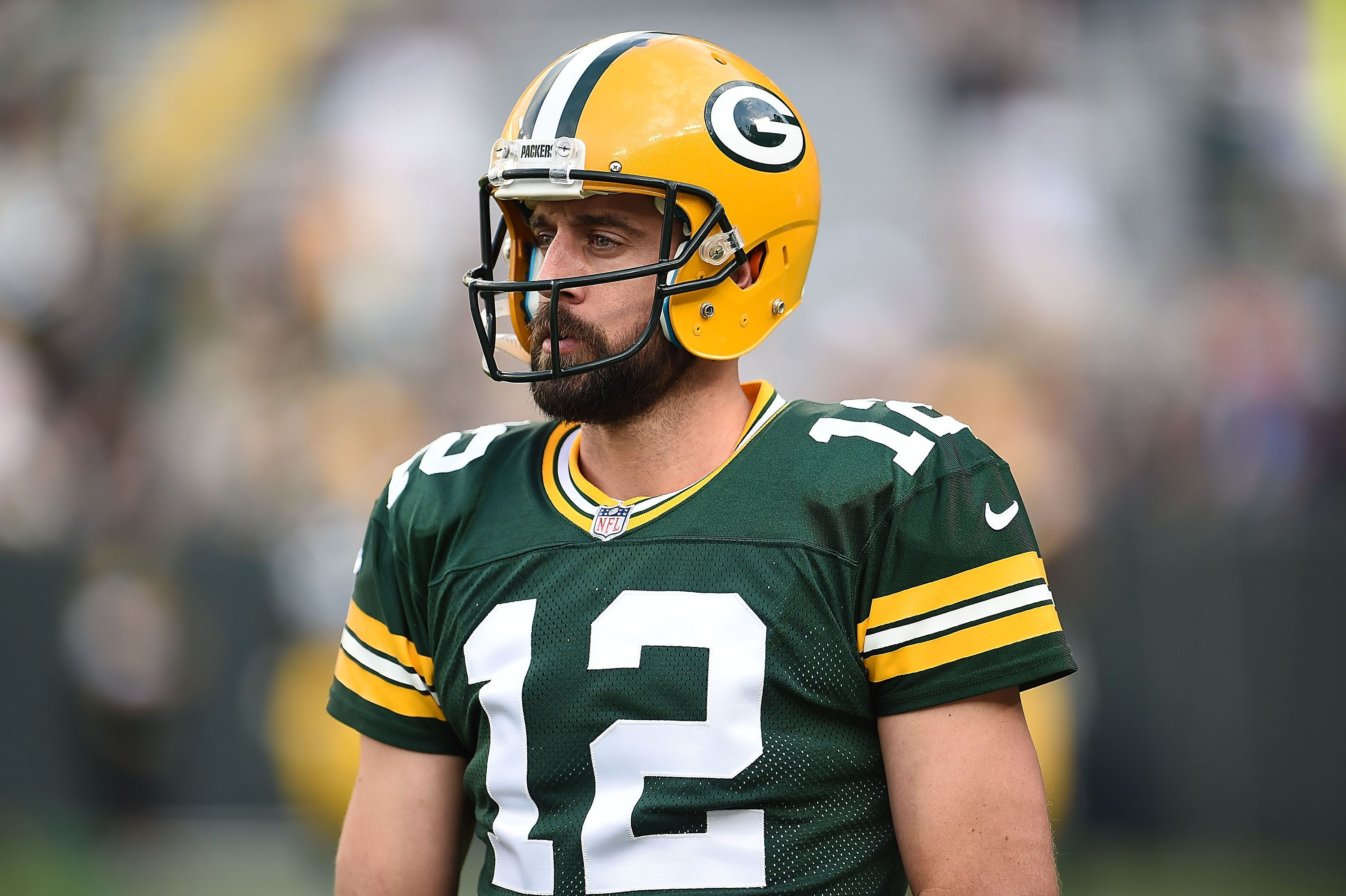 GREEN BAY, WI - AUGUST 10:  Aaron Rodgers #12 of the Green Bay Packers participates in warmups prior to a preseason game against the Philadelphia Eagles at Lambeau Field on August 10, 2017 in Green Bay, Wisconsin.  The Packers defeated the Eagles 24-9.  (Photo by Stacy Revere/Getty Images)