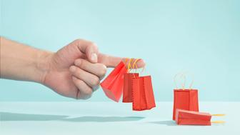 hand, finger, tiny bags, shopping, shopping bags, red bags, red, bag, blue, table, studio, studio background