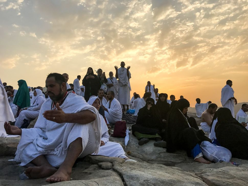 Pilgrims are seen as they pray on the Mount Arafat, also known as Jabal al-Rahmah (Mount of Mercy).