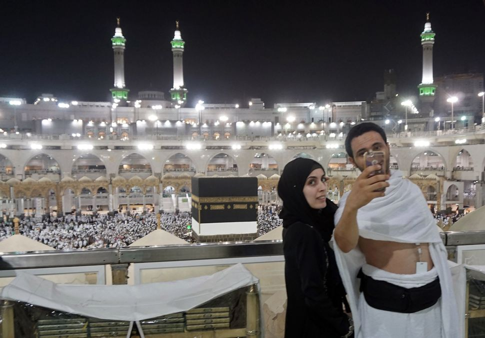 Muslim pilgrims take a selfie at the Grand Mosque in the holy Saudi city of Mecca.