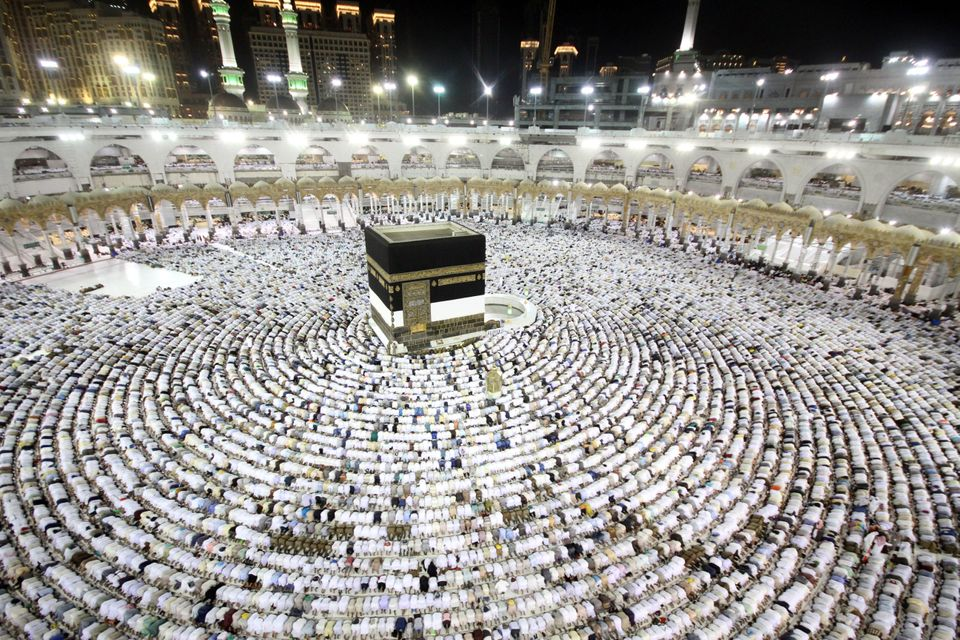 Muslim worshippers perform the evening prayers at the Kaaba, Islam's holiest