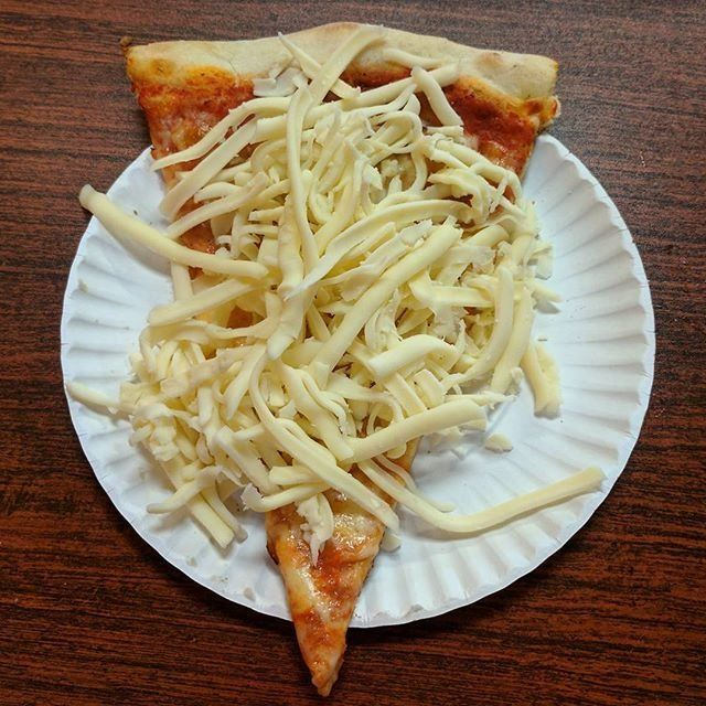 A cold cheese pizza slice from Tino's in Oneonta, New York.