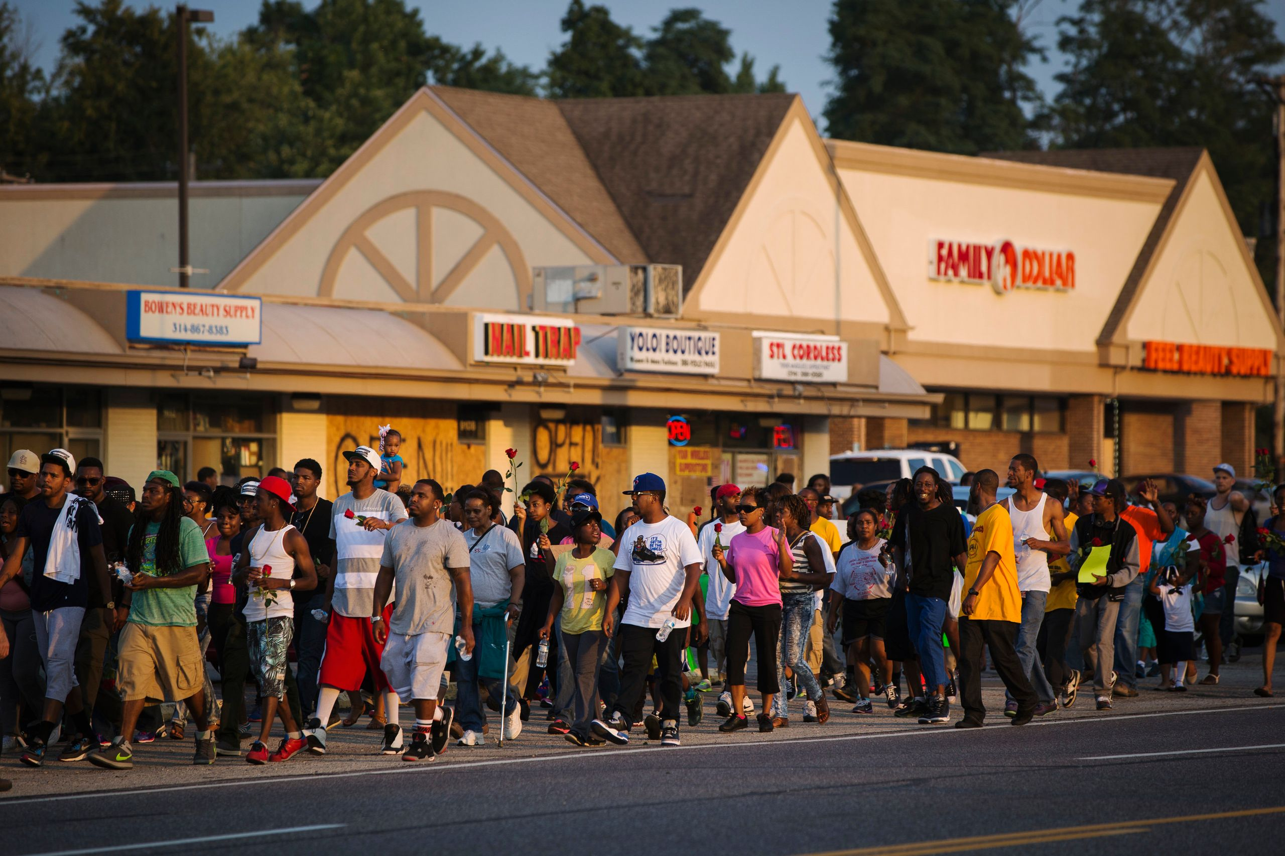 Demonstrators are seen during a peaceful march near Ferguson, Aug. 18, 2014.