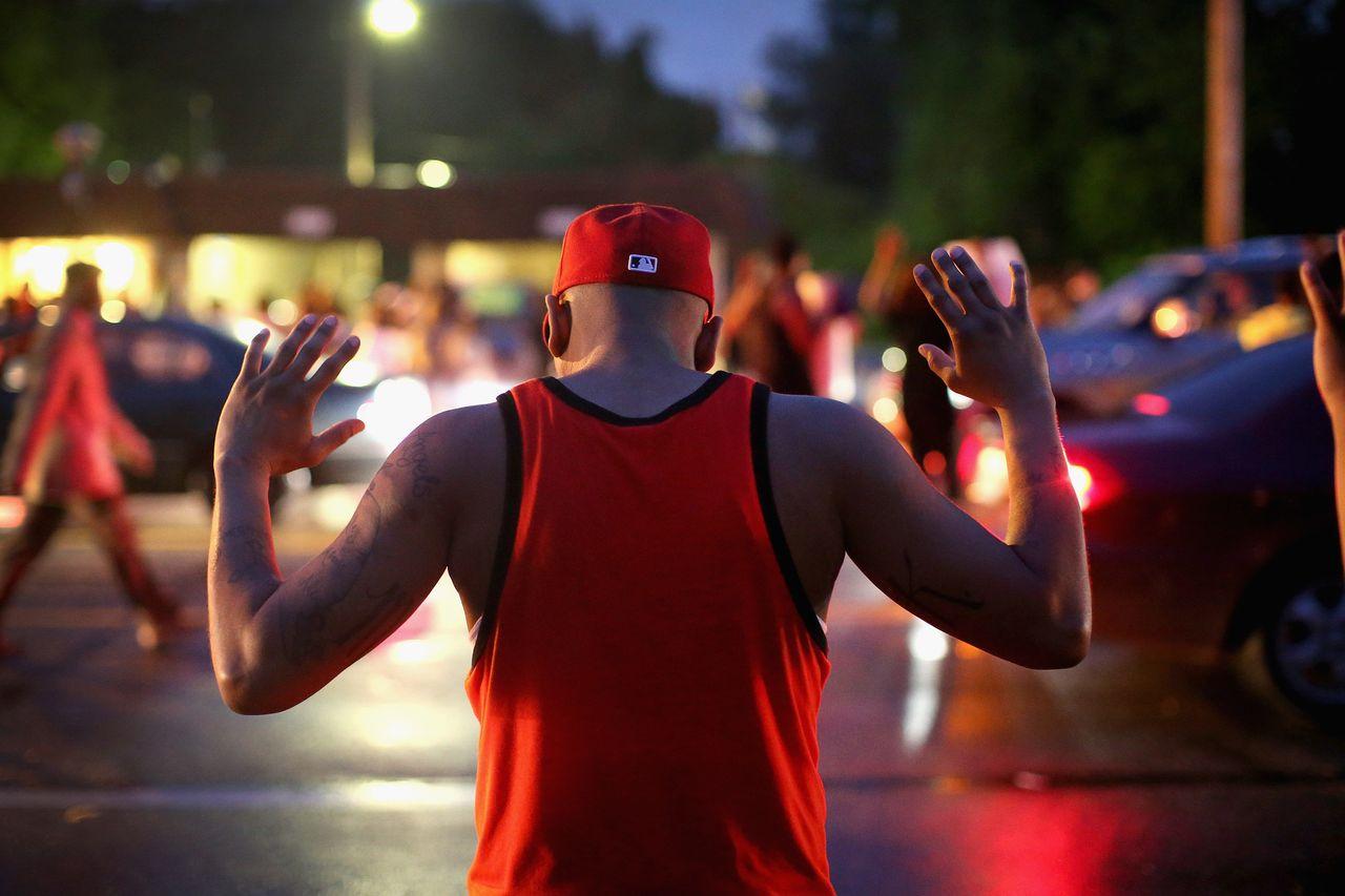 Demonstrators gather along West Florissant Avenue in Ferguson on Aug. 15, 2014.