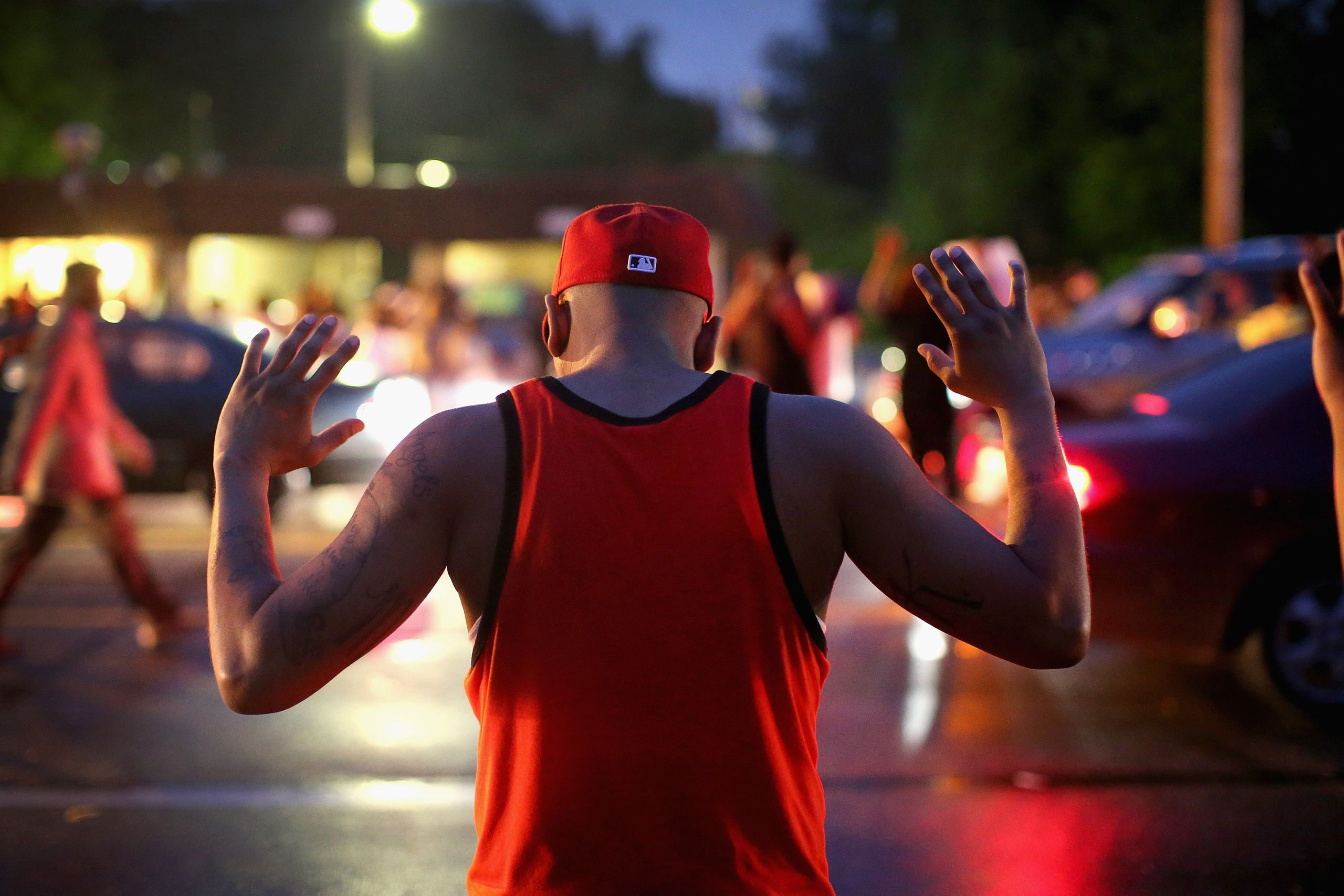 Demonstrators gather along West Florissant Avenue in Ferguson on Aug. 15, 2014.