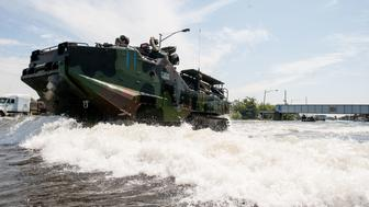 United States Marines arrive back at the launch point in Port Arthur, TX after rescuing flood victims.
