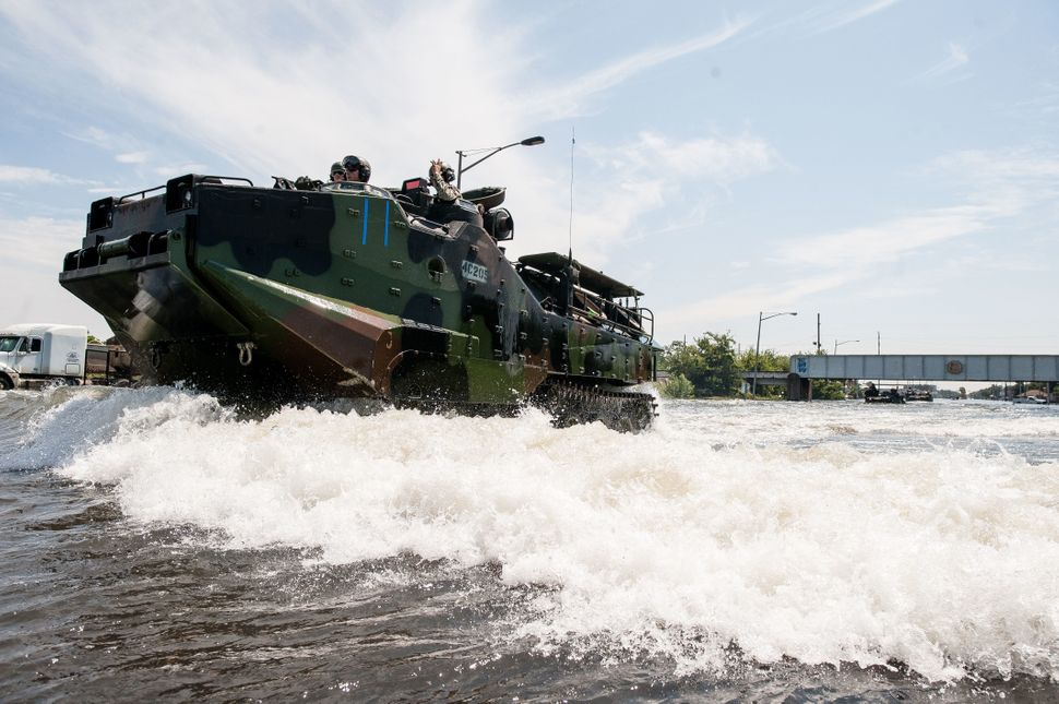 Marines return to a launch point in Port Arthur, Texas, near the Louisiana border.