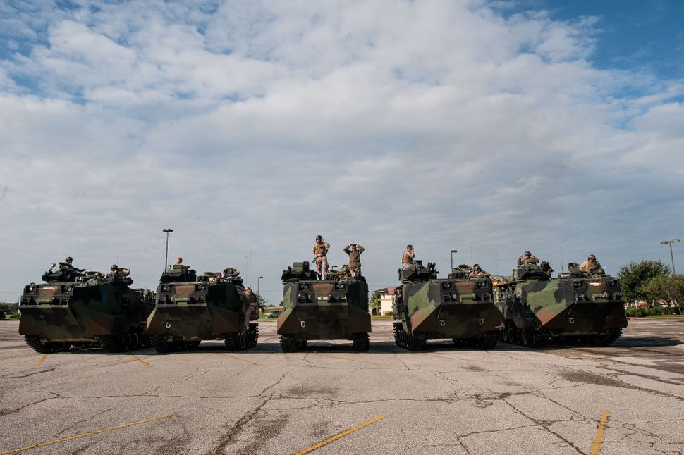 U.S. Marines arrive from Galveston Island in amphibious assault vehicles at the Central Mall in Port Arthur.