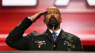 CLEVELAND, OH - JULY 18: Milwaukee County Sheriff David Clarke salutes the crowd prior to delivering a speech on the first day of the Republican National Convention on July 18, 2016 at the Quicken Loans Arena in Cleveland, Ohio. An estimated 50,000 people are expected in Cleveland, including hundreds of protesters and members of the media. The four-day Republican National Convention kicks off on July 18. (Photo by Joe Raedle/Getty Images)