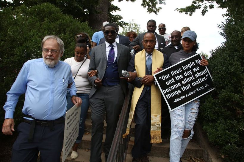 Religious leaders including <em>Rev. Cornell Brooks and activists marching together with the local community to end white sup