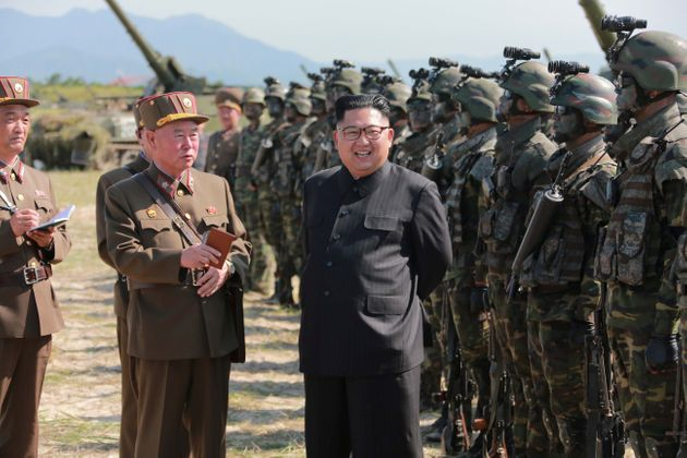 North Korean leader Kim Jong Un guides a target-striking contest of the special operation forces of the...