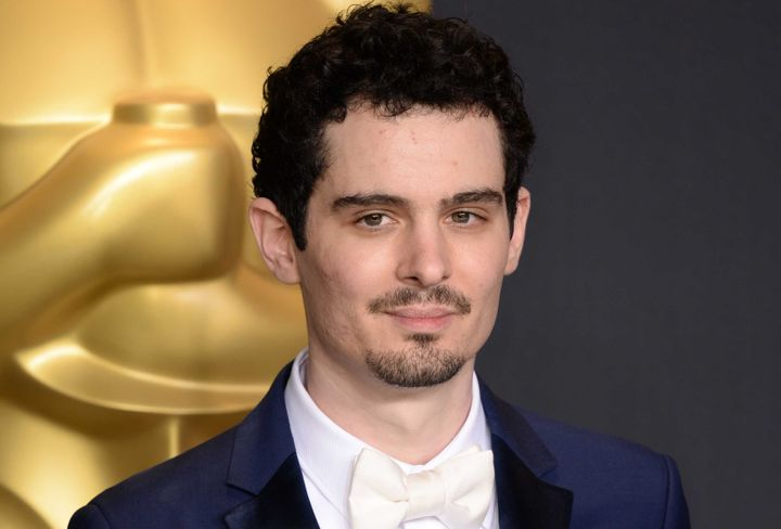 Damien Chazelle poses with the award for Directing for La La Land 89th Academy Awards.